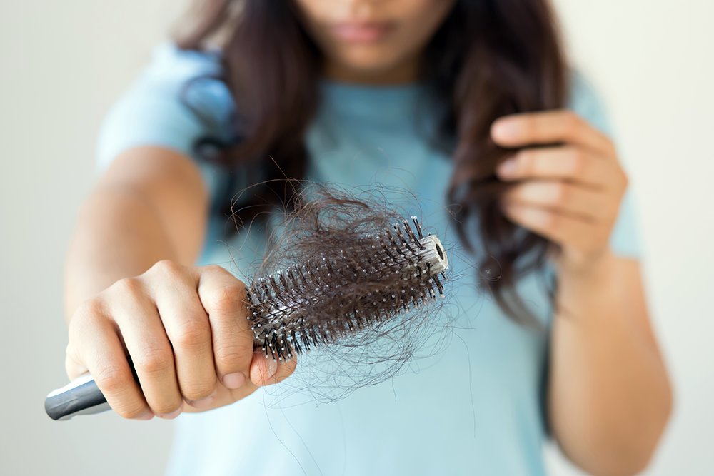 What causes pregnancy hair loss