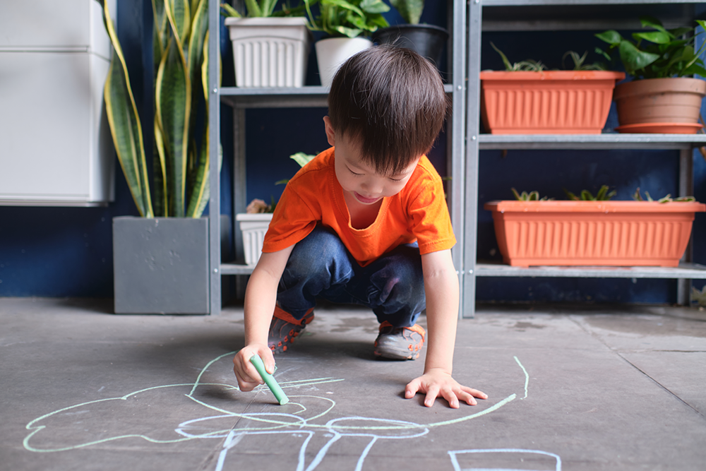 Child playing on the ground with germs